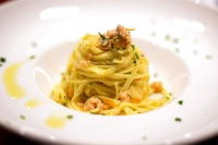 Tagliolini nests with salmon and pistachio nut from Bronte pesto