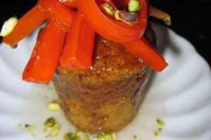 Spiced carrot baba au rhum with candied carrots and pistachio